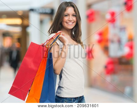 Smiling woman in a shopping mall