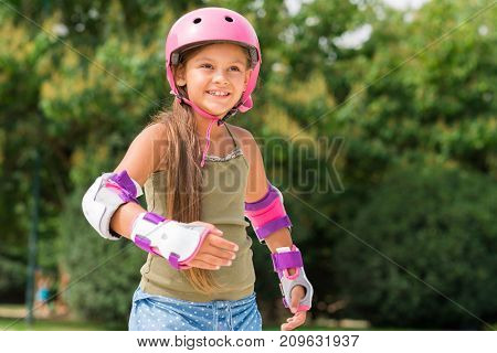 Happy girl skating in a park