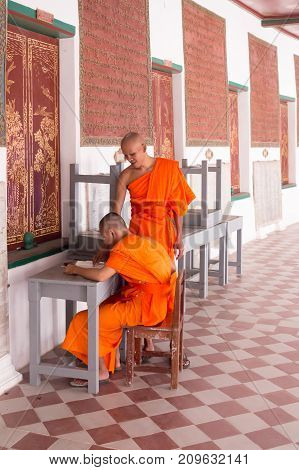 Nakhon Pathom Thailand February 2013 in the afternoon the monks study in the corridors covered in the temple because this is a quiet place