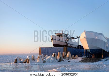 Boats covered for winter in the ice