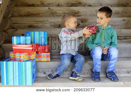 children and boxes with gifts. the concept of conjecture. Holiday scene