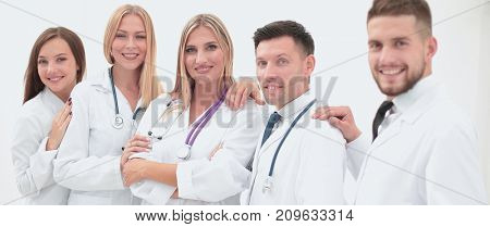 Team of medical professionals  looking at camera, smiling.