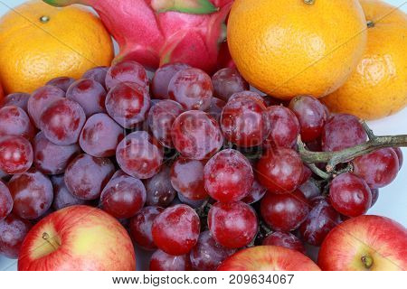Mixed Fruits As Red Seedless Grapes,orange,apple,dragon Fruit,japanese Golden Melon.
