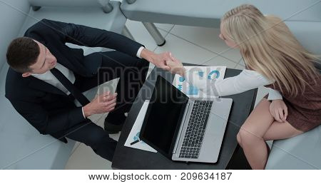 Confident business partners working in office and talking