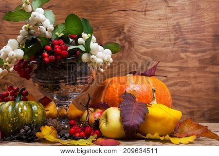 Thanksgiving Arrangement With Snowberry And Rowan In Glass Vase, Copy Space