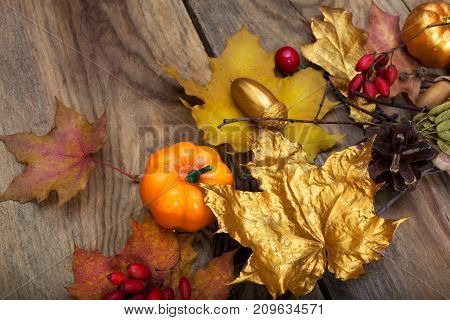 Thanksgiving Arrangement With Golden Leaves And Pumpkins