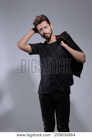Portrait of a pensive handsome man  over gray background