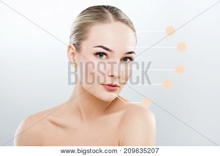 Young Girl With Naked Shoulders On Studio Background
