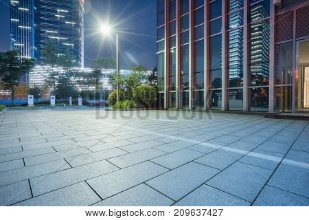 modern glass building exterior with empty pavement,copy space,shanghai,china.