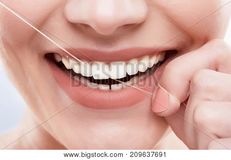 White Teeth Cleaning With Tooth Thread