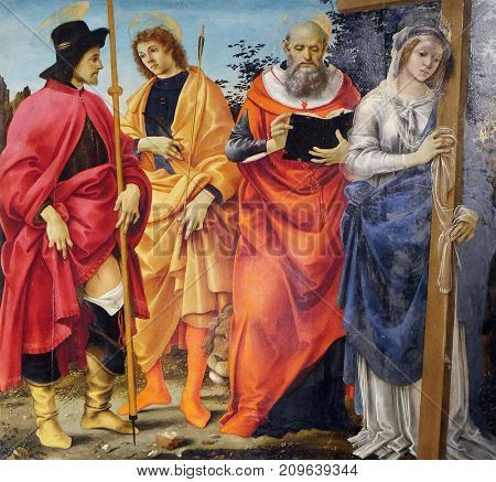 LUCCA, ITALY - JUNE 03: Pala Magrini by Filippino Lippi representing the saints Roch, Sebastian, Jerome and Helena, San Michele in Foro church in Lucca, Tuscany, Italy on June 03, 2017