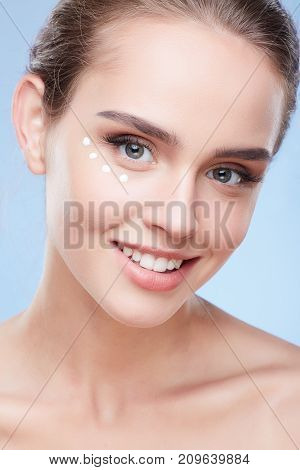 Woman With Cream Under Eyes