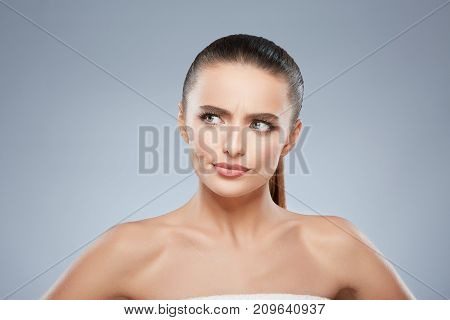 Beauty Portrait Of Suspicious Woman