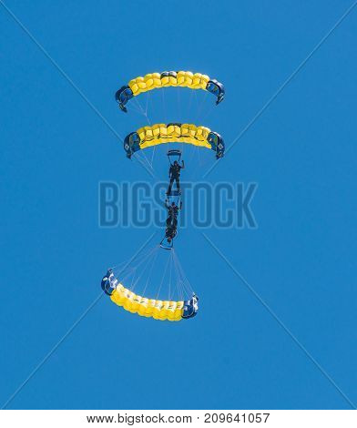 US Navy Seal Parachute Team-Leap Frogs in the sky over San Francisco Ca.  Oct 6, 2017