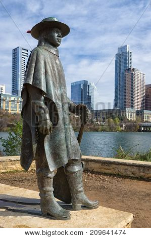 December 31, 2015 Austin Texas USA: bronze sculpture of Stevie Ray Vaughan by Ralph Helmic with the downtown in the background
