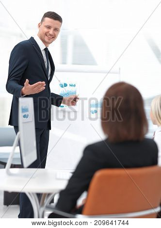Manager is discussing a new financial project with a business team.