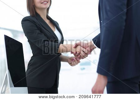 business colleagues shaking hands after a successful presentation.