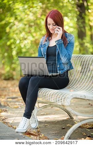 Cute Woman Working With Notebook In The Park