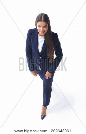 business woman walking in full length on white background