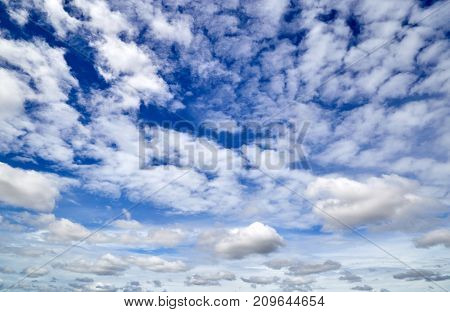 The blue sky with white clouds background