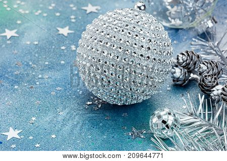 Silver Christmas Balls And Fir Branch On Festive Background With Star Confetti