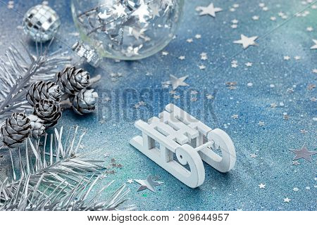 White Sledge And Christmas Holiday Decorations