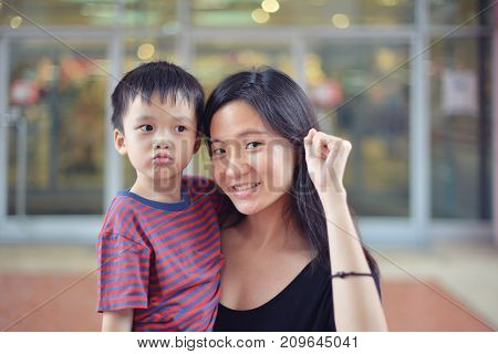 Portrait Of Young Asian Mother And Her Kid Are Happy