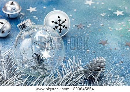 Christmas Glass Ball And Silver Jingle Bells On Blue Background