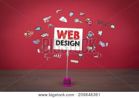 web design concept. Wooden table at the red background.