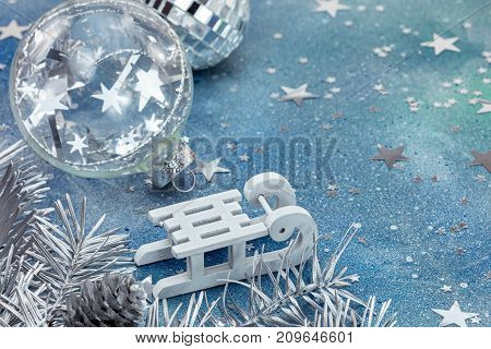 White Sledge And Christmas Glass Balls On Blue Background