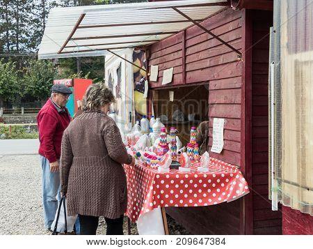 Prahova Romania October 04 2017 : Tourists buy souvenirs at a roadside store in the town Prahova Romania.