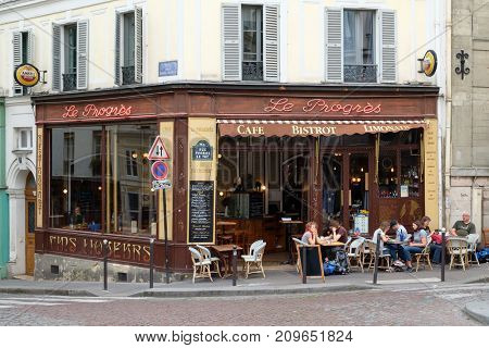 PARIS,FRANCE - JULY 30,2017 : Typical bistro in the parisian district of Montmartre