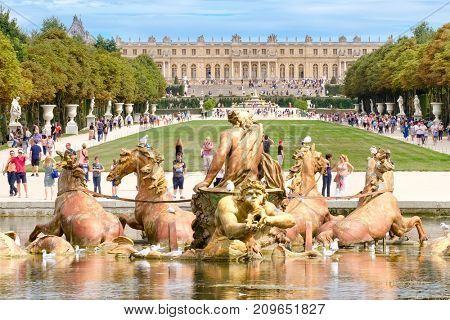 VERSAILLES,FRANCE - AUGUST 2, 2017 : The famous Apollo Fountain and the gardens of the Palace of Versailles near Paris