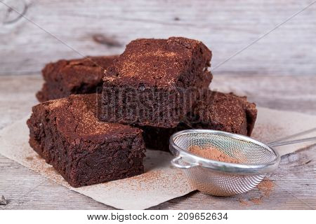 Chocolate brownie on wooden board on the table