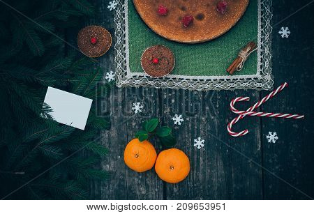 homemade christmas pie holiday dessert in new year tree decorations frame on vintage wooden table background
