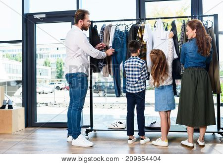 Family On Shopping In Boutique