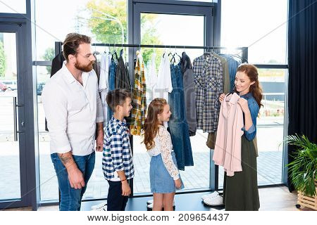 Family Shopping In Boutique
