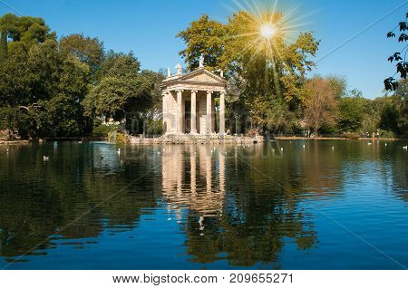 Temple of Esculapio at sunrise located at the beautiful garden of Villa Borghese, Rome, Italy