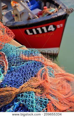 WHITSTABLE, UK - OCTOBER 15, 2017: Colorful fishing nets at the fishing Harbor