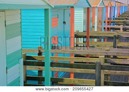 A row of colorful wooden Huts along the seafront in Whitstable, UK