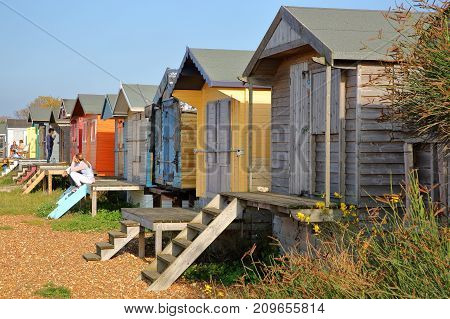 WHITSTABLE, UK - OCTOBER 15, 2017: A row of colorful wooden Huts overlooking the sea