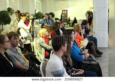 PERM RUSSIA - FEB 12 2017: Audience and photographers at Wedding Fair Perm 2017