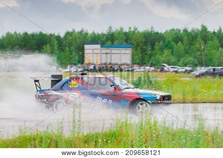 PERM RUSSIA - JUL 22 2017: Drifting car on wet track during Open Ural Championship Drift 2017