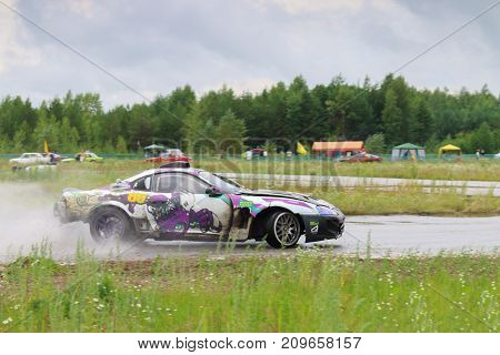 PERM RUSSIA - JUL 22 2017: Drifting car with smoke move on track at Open Ural Championship Drift 2017