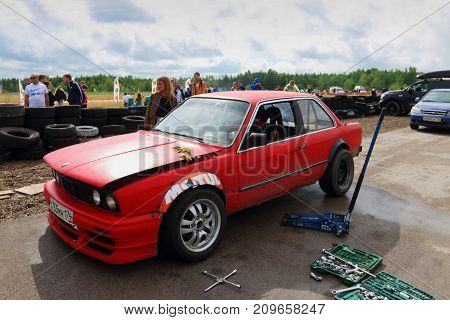 PERM RUSSIA - JUL 22 2017: Red competitor car and tools for repair at Open Ural Championship Drift 2017