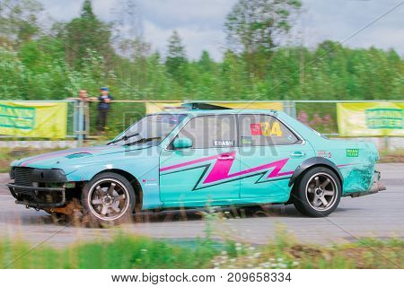PERM RUSSIA - JUL 22 2017: Drifting fast green car on asphalt track at Open Ural Championship Drift 2017