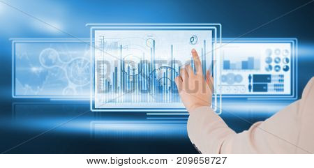 Businesswoman pointing against computer graphic image of business diagrams in 3d