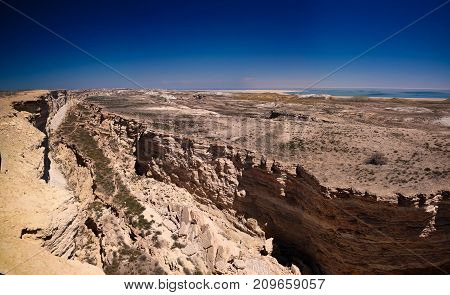Panorama view to Aral sea from the rim of Plateau Ustyurt near Duana cape in Karakalpakstan, Uzbekistan