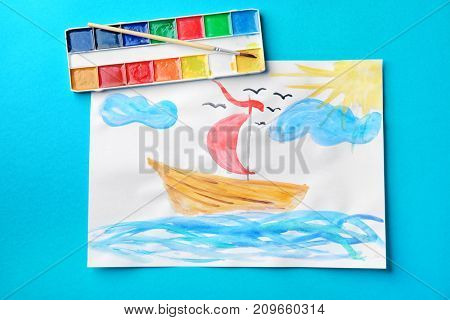 Child's painting of ship in sea on blue background
