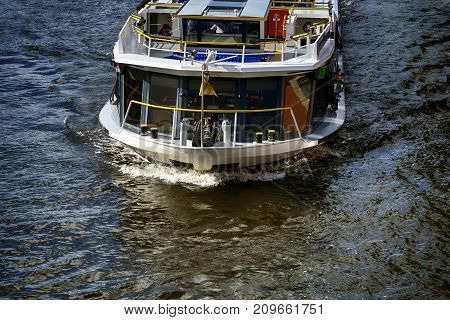 Berlin Germany - October 8 2017: Tourist boat on Spree River in the middle of Berlin October 8 2017.